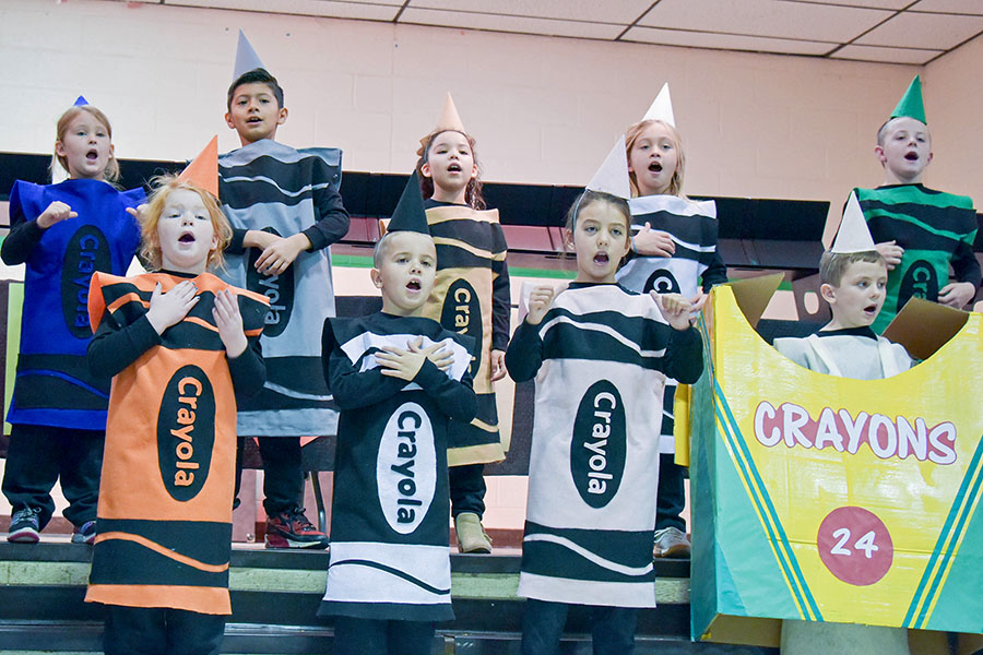 kids in crayon outfits singing