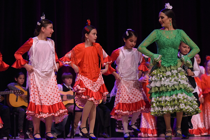 girls in flamenco dresses on stage