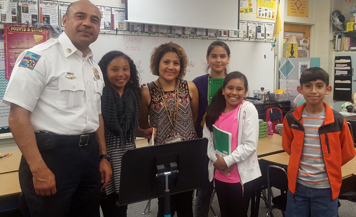 Chief Gomez with four students and teacher